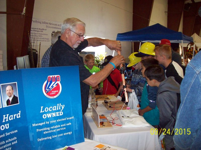 Member of Foundation for Water Energy Education demo at fair photo