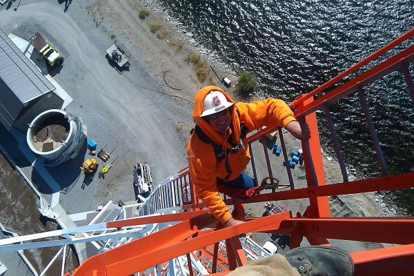 Crew Member Climbing Transmission Tower picture